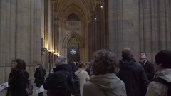 Crowd of tourists walk inside Saint Vitus Cathedral, high ceilings, Prague Stock Footage
