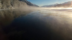 Hovering over Misty River in Winter with Floating Ice Aerial HD Stock Footage