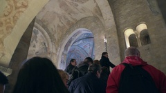 Tourists at Basilica of St George chapel, view of ceiling, Prague Castle Stock Footage