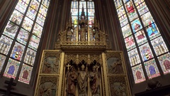 Gold religious statue, stained glass art, Saint Vitus Cathedral, Prague Castle Stock Footage