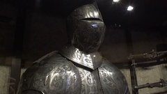 Knight steel armor and helmet on display, royal family castle, Prague Stock Footage