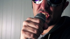 Alternative rock music singer singing song into microphone Stock Footage