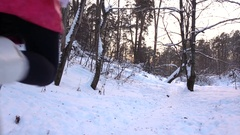 Slow motion video of slim girl in red jacket running from the camera in winter Stock Footage