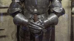 Knight steel armor, hands on sword, medium shot, royal family castle, Prague Stock Footage