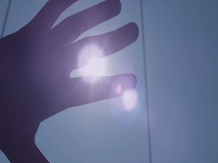 Hand Palm Sunshine Passing Through. Hand in silhouette raised up to the sun. Stock Footage