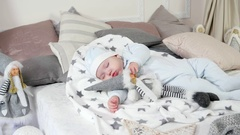 Small child sleeps, sweet baby sleeping on parents' bed in a cozy atmosphere in Arkistovideo