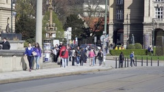 Cars and People cross Mánes Bridge, busy city street, Prague, Czech Republic Stock Footage