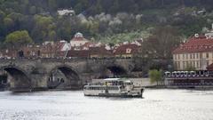 Tourist cruise boat ship, Vltava river, Charles Bridge, Prague, Czech Republic Stock Footage