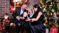 Parents play with children, happy family New Year's eve, portrait of a happy Stock Footage