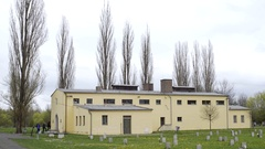 People enter Theresienstadt crematorium, Jewish cemetery, Terezin, Czech R. Stock Footage