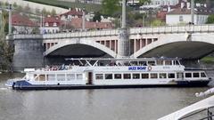 Tourist cruise boat ship, jazz boat, Mánes Bridge, Vltava river, Prague Stock Footage