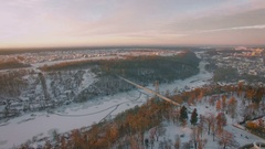Aerial view of town bridge cross river at sunrise Stock Footage