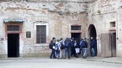 Group tour Theresienstadt concentration camp, Terezin, Czech Republic Stock Footage