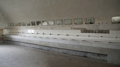 Old crumbling bathroom washroom, many sinks, Theresienstadt camp Stock Footage