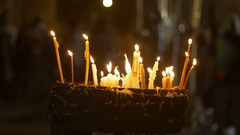 Candles in the Holy Sepulchre Church in Jerusalem Stock Footage