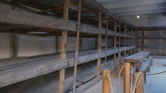 Wooden bunk beds, Theresienstadt concentration camp, Terezin, Czech Rep. Stock Footage