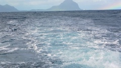 Wavy ocean and distant island, view from the ship Stock Footage