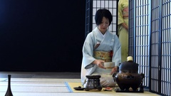 Beautiful japanese woman during the tea ceremony Stock Footage