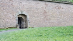 Entrance gate in red brick fortification wall, Theresienstadt camp, fortress Stock Footage