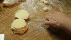 Roll out the dough for dumplings Stock Footage