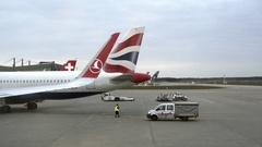 Parked British Airways airplane tail, ground crew, Tegel Airport, Berlin Stock Footage
