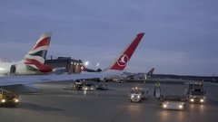 Turkish Airways flight reverses from terminal, taxi to runway, Tegel Airport Stock Footage