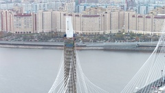 Close aerial shot of cable-stayed bridge support or pylon at the Neva river on Stock Footage