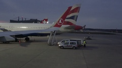 Ground crew enters British Airways plane from rear stairway, Tegel Airport Stock Footage