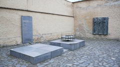 Eternal flame, remembrance of victims, Theresienstadt concentration camp Stock Footage