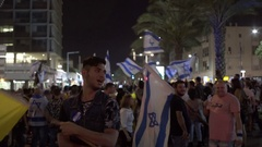 Ultra right wing protest, people wave Messiah, Israeli flags, Tel Aviv, Israel Stock Footage