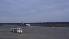 Air Berlin Bombardier Q400 airplane taxis at Tegel Airport runway, Berlin Stock Footage
