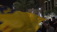 Ultra right wing settlers protest, man waves Messiah flags, Tel Aviv, Israel Stock Footage