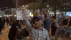 Man holds Hebrew sign to release shooting soldier, right wing protest, Israel Stock Footage