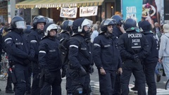Male and female riot police officers observe order, 1st of May, Berlin Stock Footage
