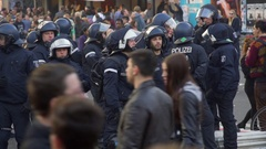 Group of riot police officers maintain order in Berlin streets, 1st of May Stock Footage