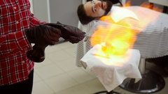 Barber razor ignites the flame of fire. Slow motion Stock Footage