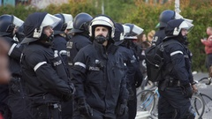 German riot police with helmets maintain order, 1st of May, Berlin, Germany Stock Footage