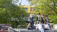 Young people on roof, drink relax in sun, 1st of May, Gorlitzer Park, Berlin Stock Footage