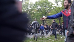 Riot police run and disperse crowd, violence in labor day protest, Berlin Stock Footage
