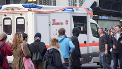 Emergency ambulance drives through busy street in Berlin, Germany Stock Footage
