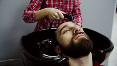 Barber Washing Male Hair in a Barbershop. Slow motion Stock Footage