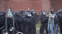 Riot police run away from protesters, violence in labor day protest, Berlin Stock Footage