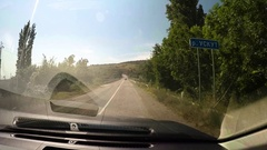 Vehicle point-of-view driving on coastal serpantin crimean road. Blue sea, green Stock Footage