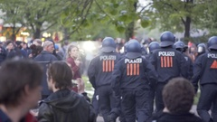 Riot police outnumbered by protesters, retreat, labor day rally, Berlin Stock Footage