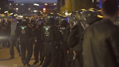 Riot police officers, night time, labor day workers holiday, Berlin, Germany Stock Footage