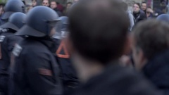 Riot police try to maintain order in violent protest rally, labor day, Berlin Stock Footage