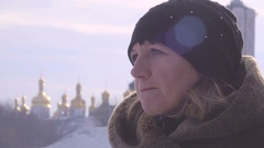 Portrait of a young woman on a background of golden domes Stock Footage