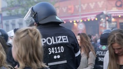 Riot police officer with helmet laughing, 1st of May, labor day, Berlin Stock Footage