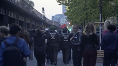 Riot police follow labor day socialist workers left wing protest, Berlin Stock Footage
