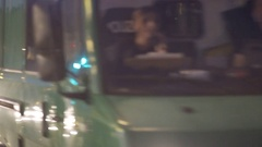 Police van passes riot police officers, night time, Berlin, Germany Stock Footage